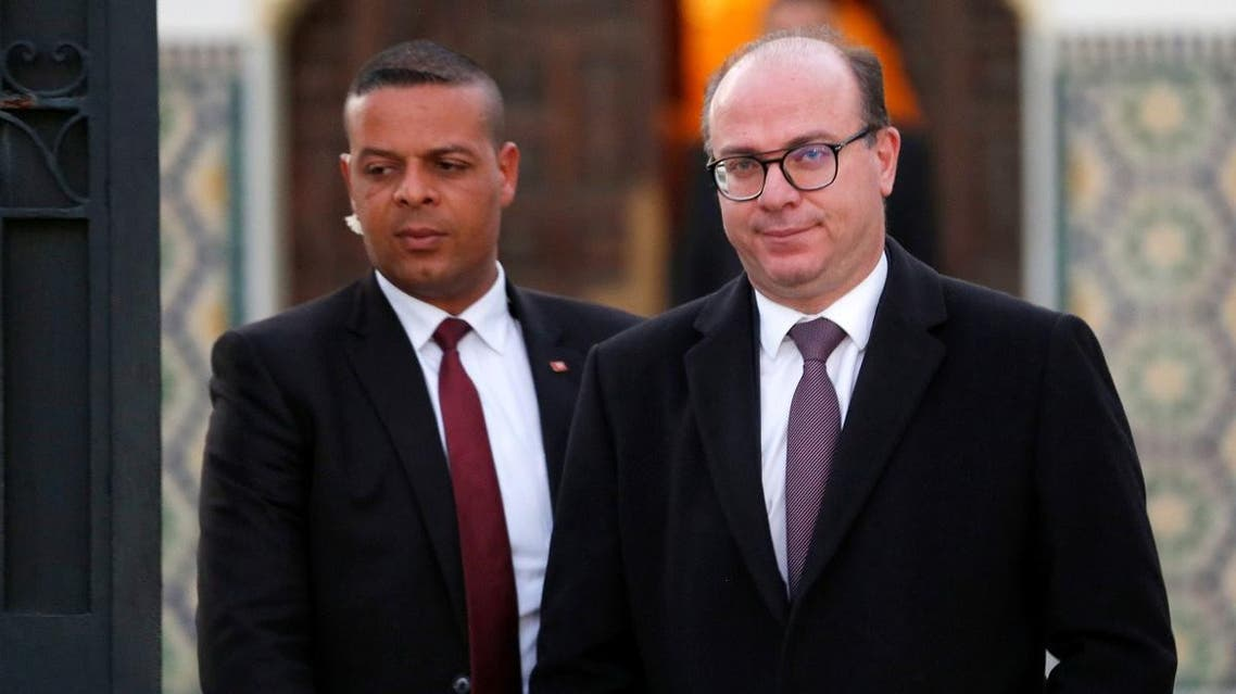 Tunisian Prime Minister Elyes Fakhfakh leaves for a meeting with Tunisian President Kais Saied (not pictured) in Tunis, Tunisia February 15, 2020. (Reuters)