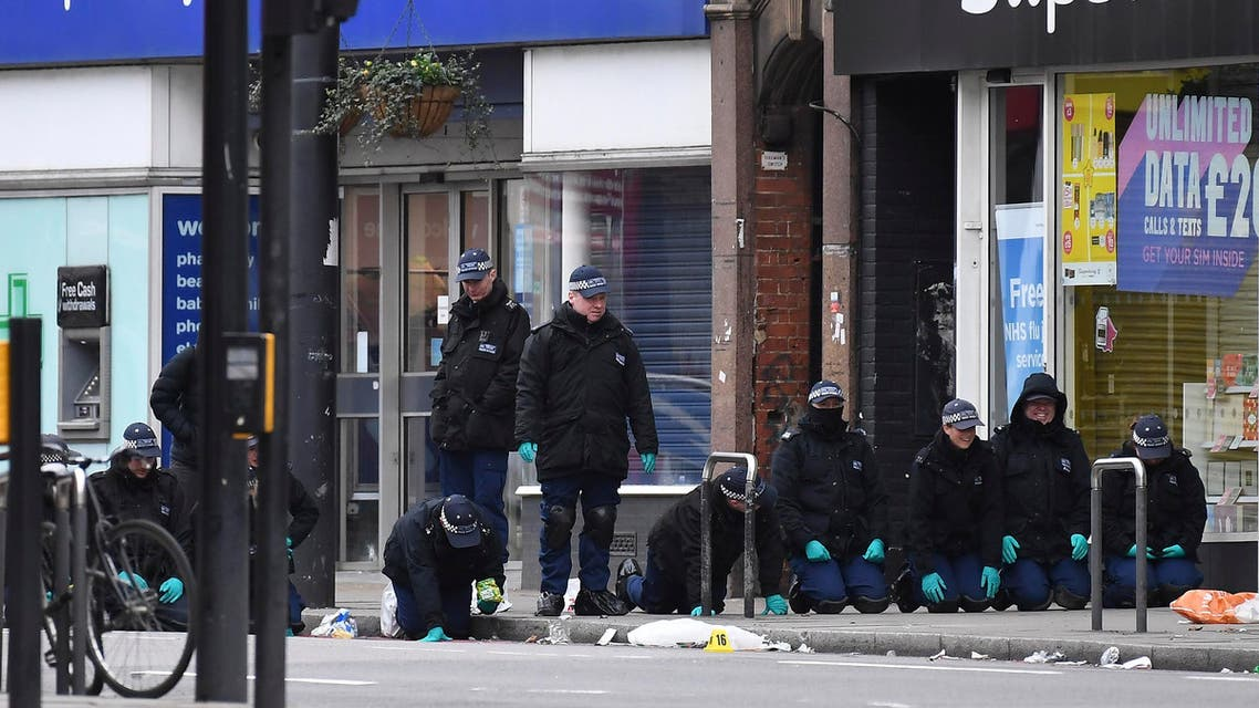 Police officers work at the scene of Sunday's terror stabbing attack in the Streatham area of south London on Feb. 3, 2020. (AP)