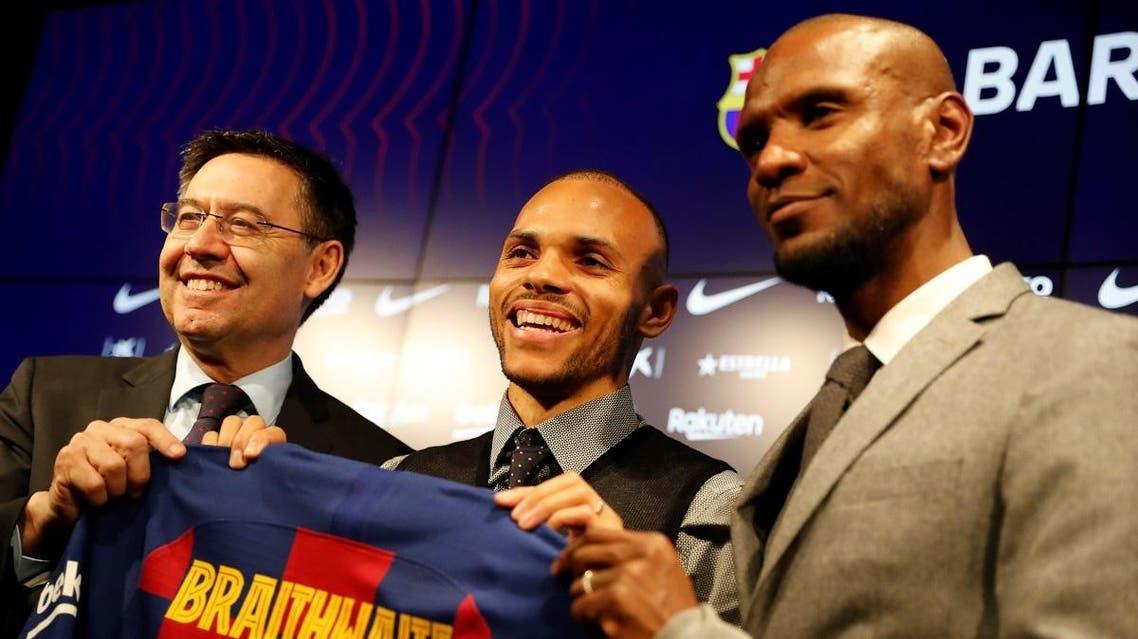 Barcelona president Josep Maria Bartomeu, new signing Martin Braithwaite and sports director Eric Abidal pose during the presentation. (Reuters)