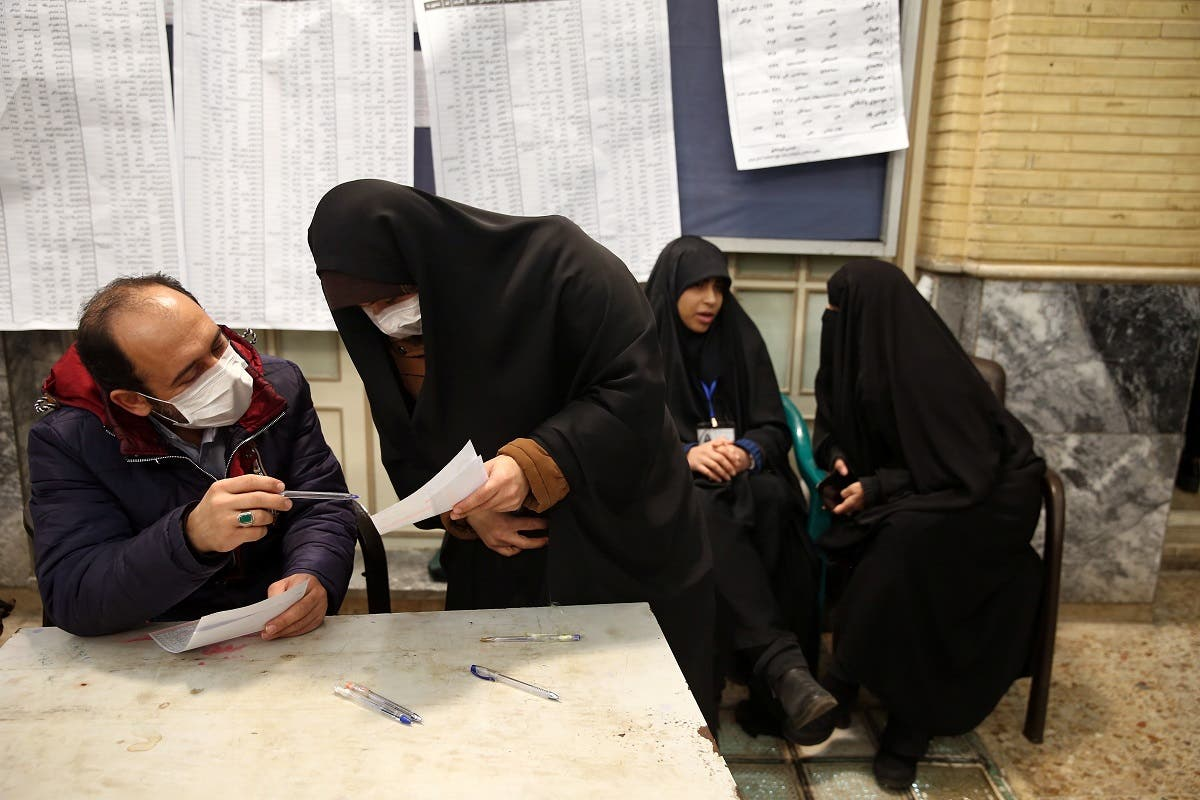 An Iranian man casts his vote during parliamentary elections at a polling station in Tehran. (Reuters)