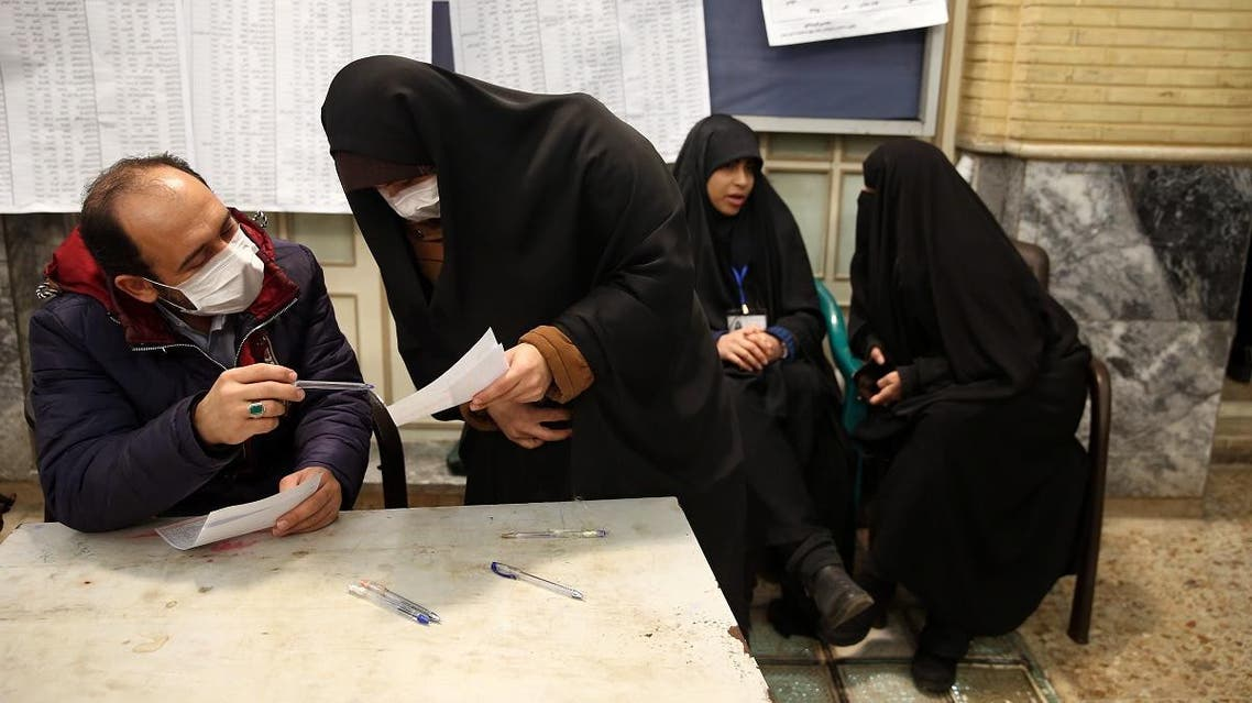 Iranian man casts his vote during parliamentary elections at a polling station in Tehran. (Reuters)