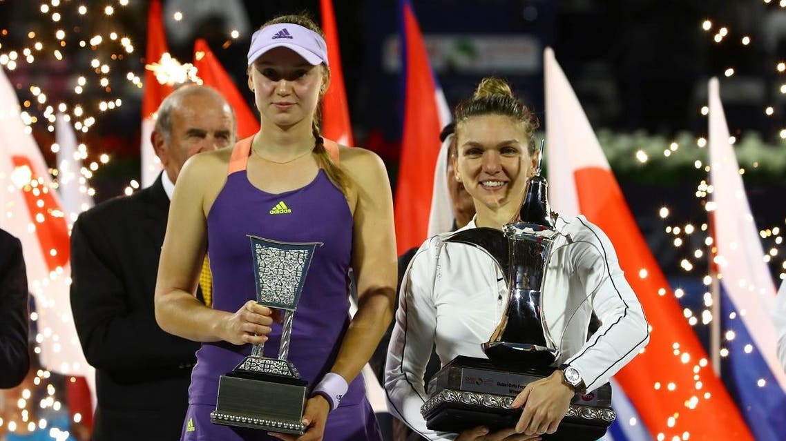 Romania's Simona Halep poses with a trophy after winning the final alongside runner up Kazakhstan's Elena Rybakina. (Reuters)