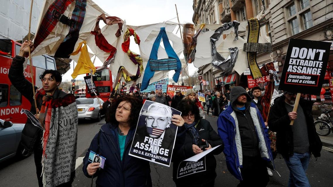Demonstrators protest against the extradition of Julian Assange, in London. (Reuters)