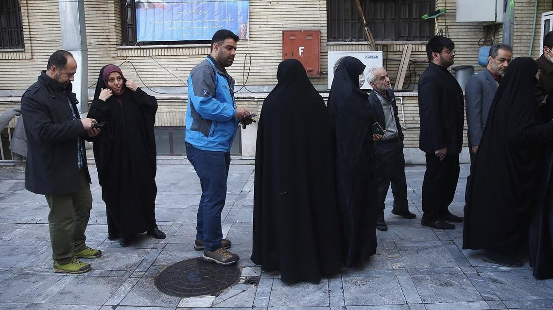 Iranians wait in line to vote at a polling station during parliamentary elections in Tehran. (Reuters)