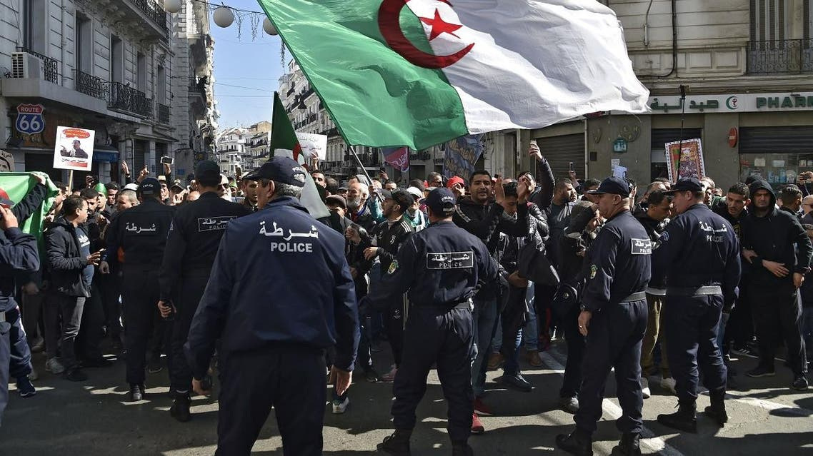 Members of the Algerian police block the progress of an anti-government demonstration heading towards the presidential palace in the capital Algiers, on February 22, 2020. (AFP)