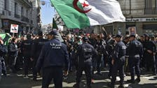Thousands of Algerians hit streets of capital on protest movement anniversary