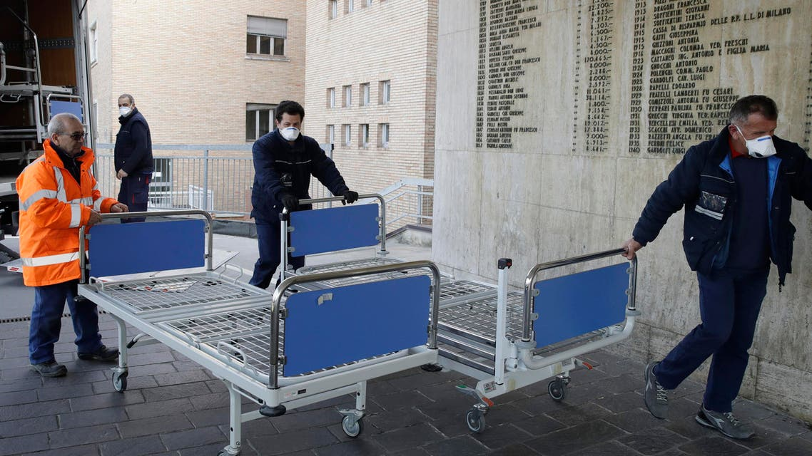 Personnel carry new beds inside a hospital of Codogno, near Lodi in Northern Italy, on Feb. 21, 2020. (AP)