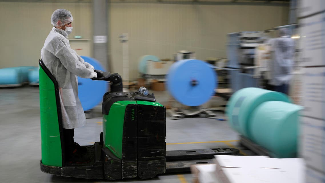 An employee wearing a protective mask works at the Kolmi-Hopen company's factory in Saint-Barthelemy-d'Anjou. (Reuters)