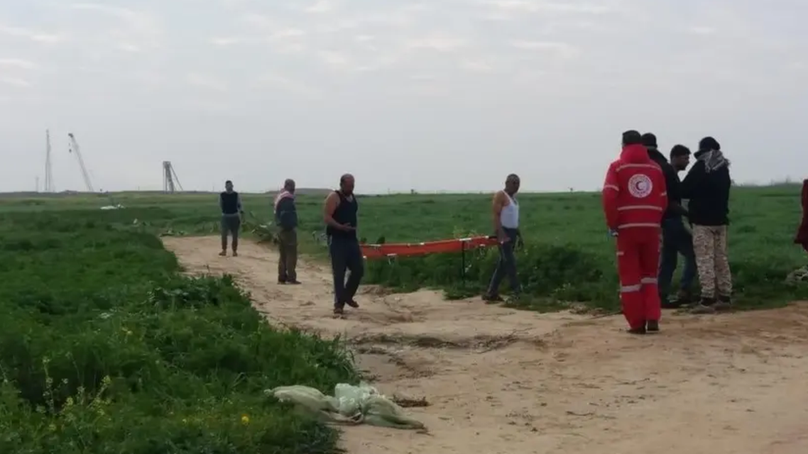 Red Crescent medics recover the body of a martyr from the site, east of Khan Yunis. (Supplied)