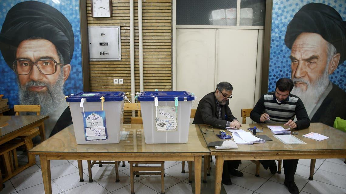 Poll workers are seen during parliamentary elections at a polling station in Tehran. (Reuters)