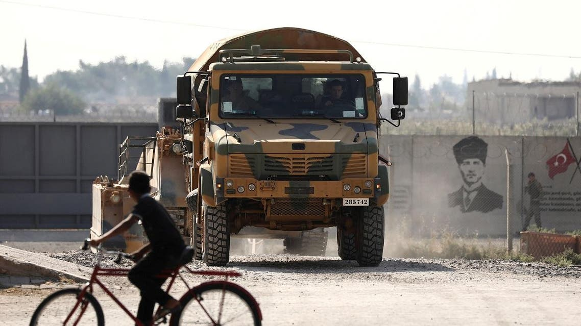 Turkish soldiers in a military vehicle return from the Syrian town of Tal Abyad, as they are pictured on the Turkish-Syrian border in Akcakale, Turkey, October 24, 2019. (Reuters)