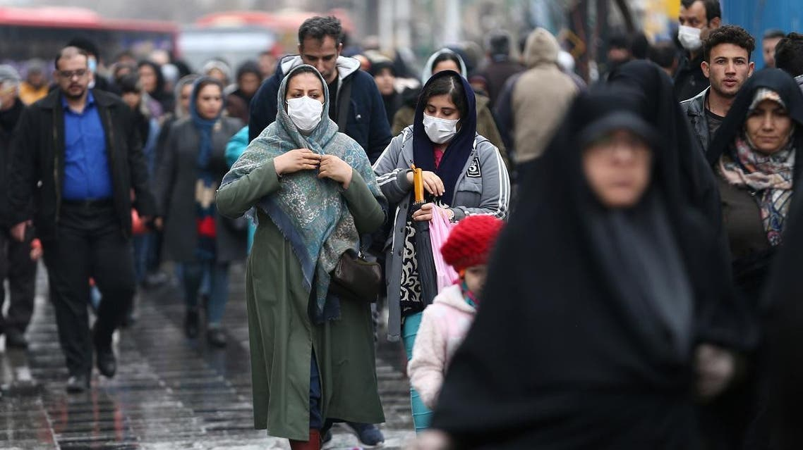 Iranian women wear protective masks to prevent contracting a coronavirus, as they walk at Grand Bazaar in Tehran, Iran February 20, 2020. (Reuters)