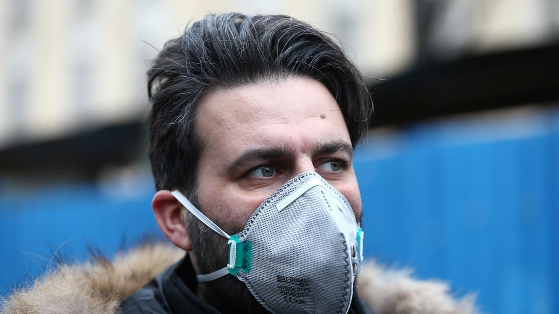 An Iranian man wearing a protective mask to prevent contracting a coronavirus walks at Grand Bazaar in Tehran, Iran February 20, 2020. - Reuters
