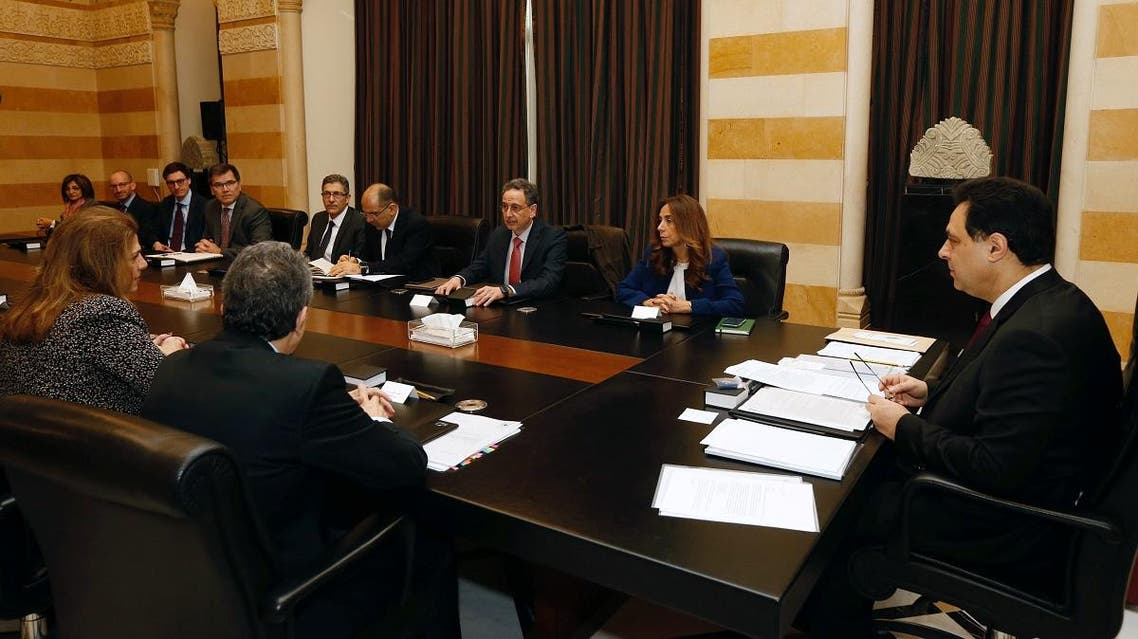 Lebanese Prime Minister Hassan Diab and officials meet with a team of IMF experts at the government palace in Beirut, on February 20, 2020. (Reuters)