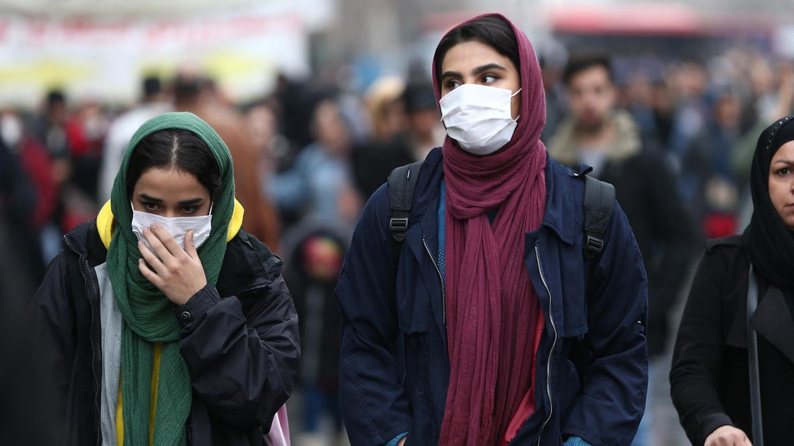 Iranian women wear protective masks to prevent contracting a coronavirus, as they walk at Grand Bazaar in Tehran, Iran. (Reuters)
