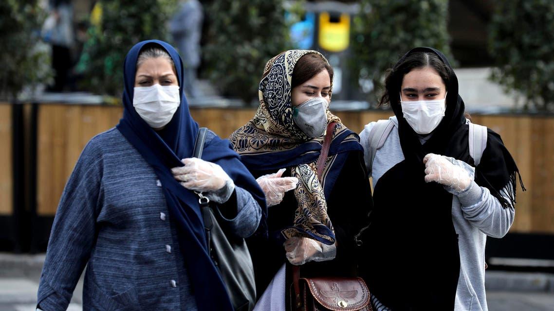People wear masks to help guard against the coronavirus on a street in Tehran on Feb. 23, 2020. (AP)