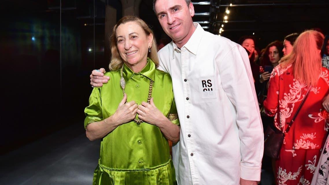 راف سيمونز وميوتشيا برادا في عرض مجموعة برادا الخاصة برحلات2019