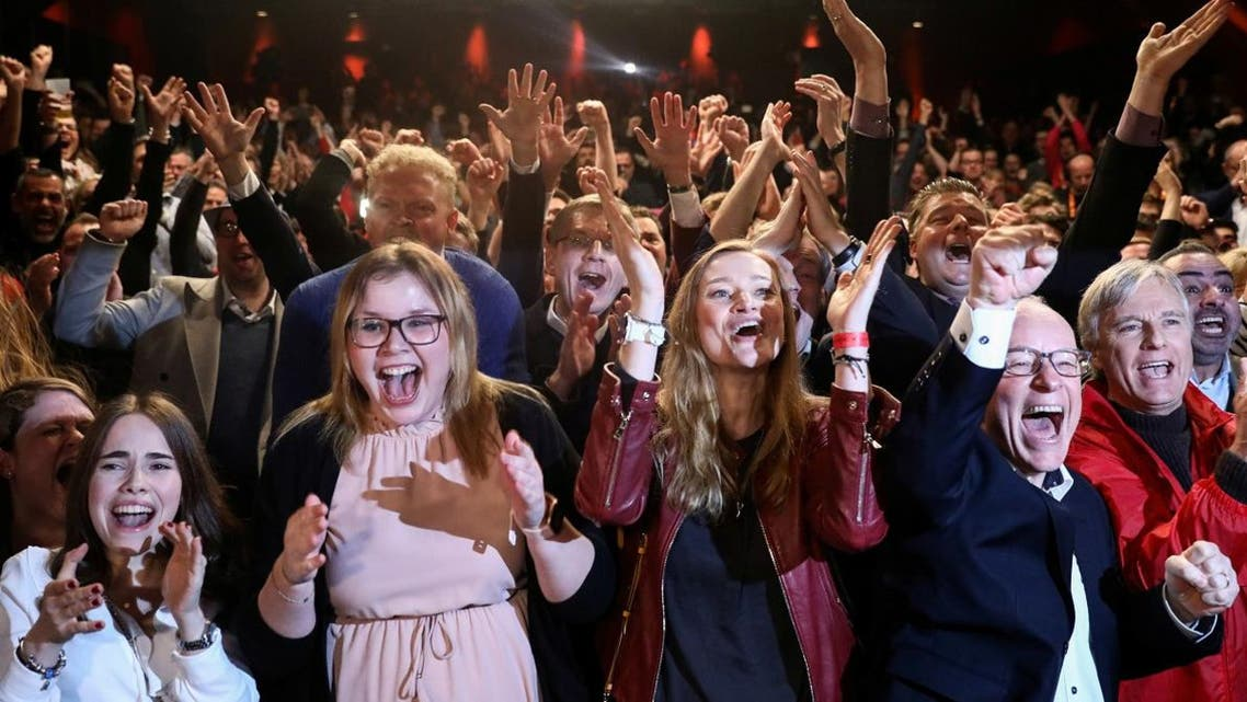 German Social Democratic Party (SPD) supporters react after first exit polls for the Hamburg state election in Hamburg, Germany, on February 23, 2020. (Reuters)