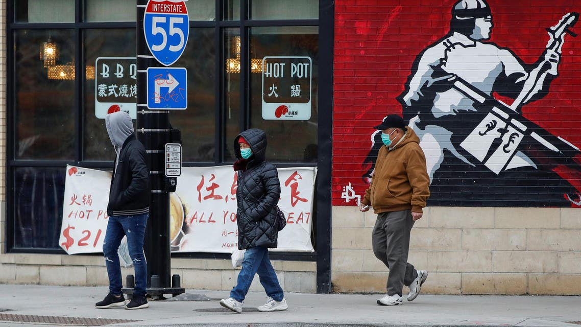 People wear masks in Chinatown following the outbreak of the novel coronavirus, in Chicago, Illinois, US January 30, 2020. (Reuters)