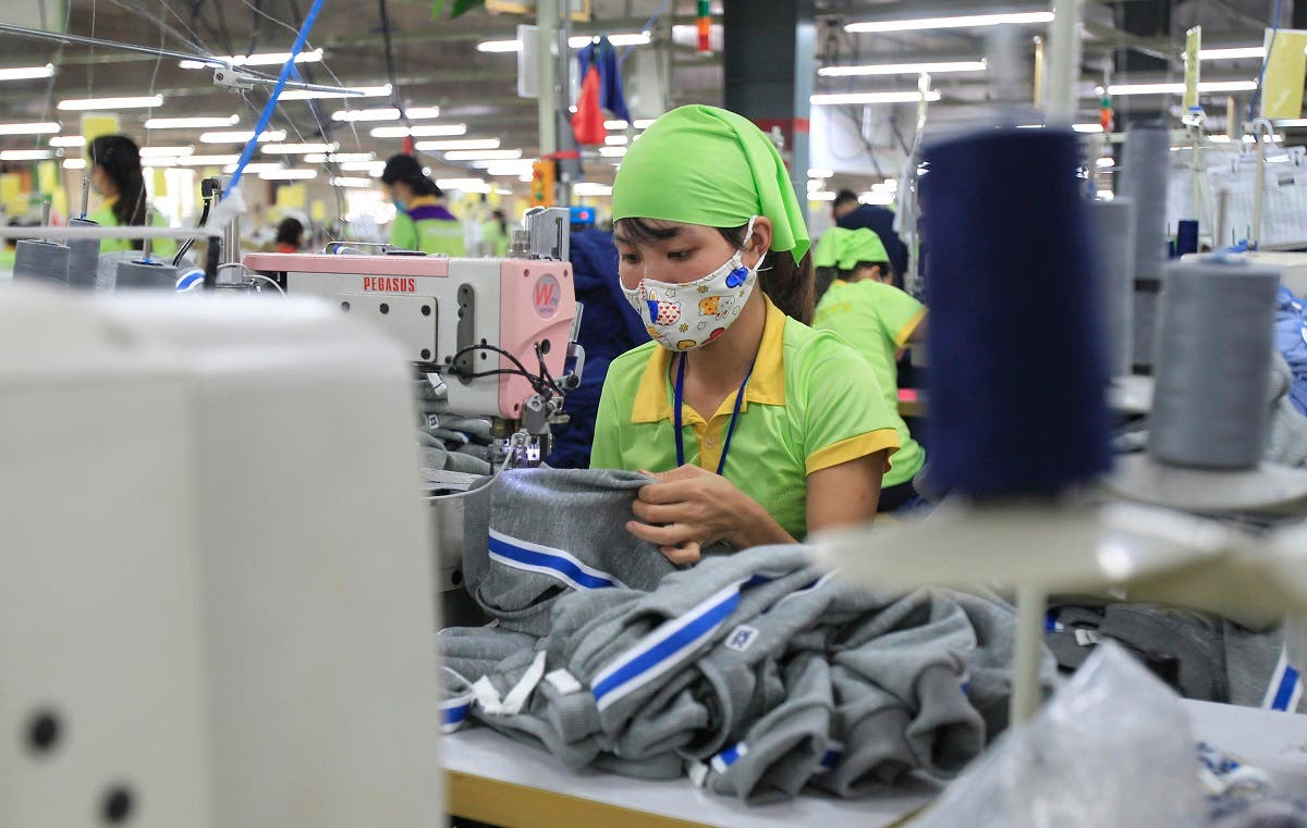A garment worker sews clothes at Pro Sports factory in Nam Dinh province, Vietnam. (File photo: AP)