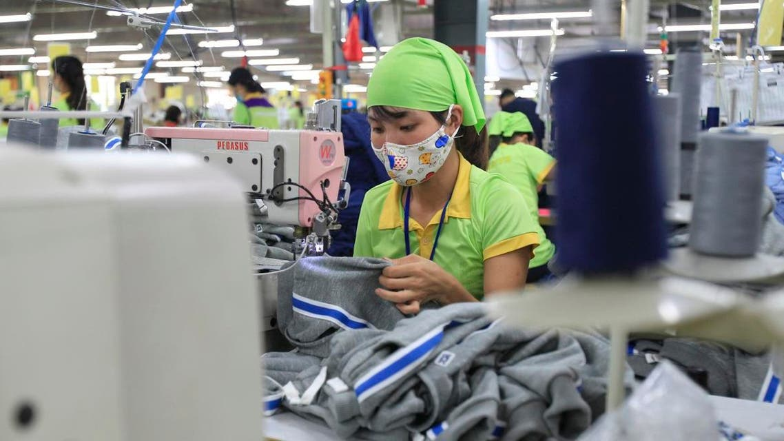 In this Oct. 24, 2017, photo, a garment worker sews clothes at Pro Sports factory in Nam Dinh province, Vietnam. (File photo: AP)