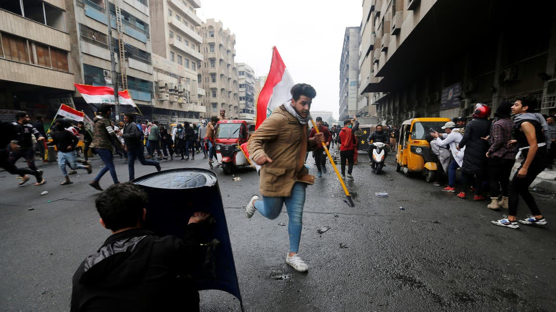 Iraqi demonstrators run away from security forces during the ongoing anti-government protests in Baghdad, Iraq February 25, 2020. REUTERS/Wissm al-Okili