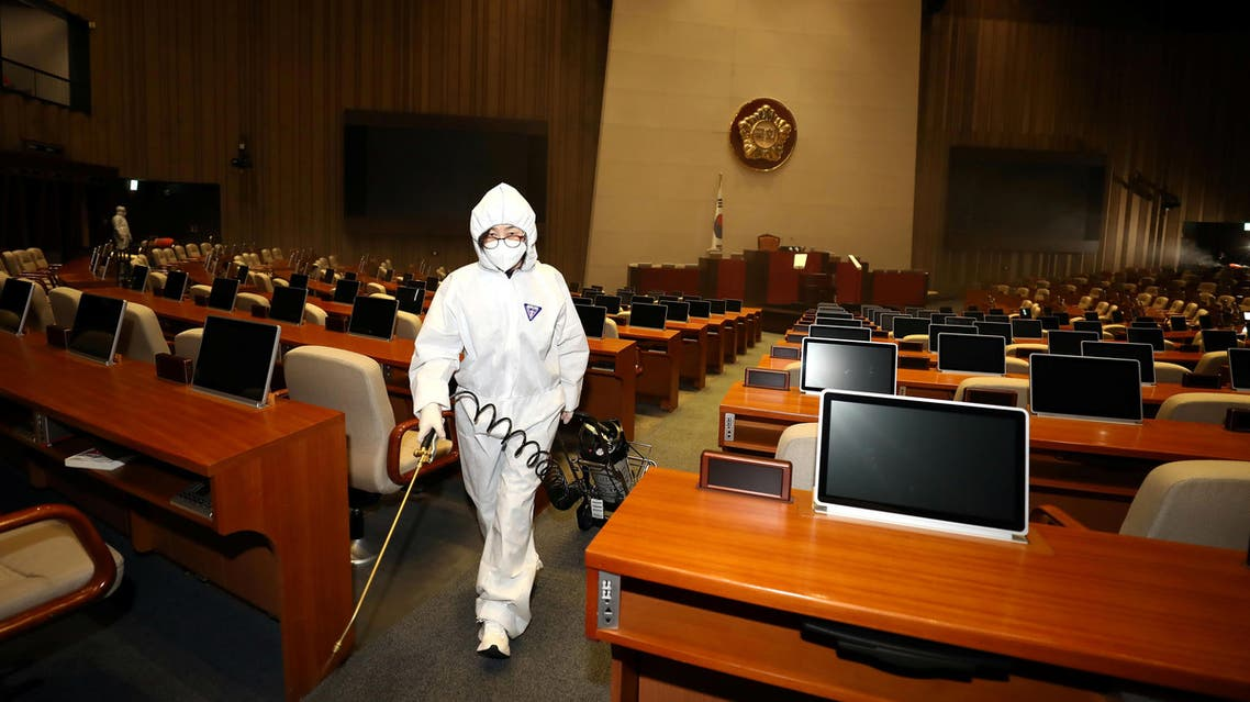Employees from a disinfection service company sanitize the National Assembly in Seoul, South Korea, on February 25, 2020. (Reuters)
