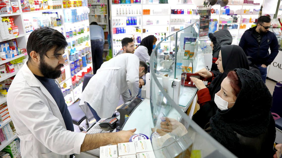Pharmacists talk with customers at a drugstore in downtown Tehran on Feb. 25, 2020. (AP)