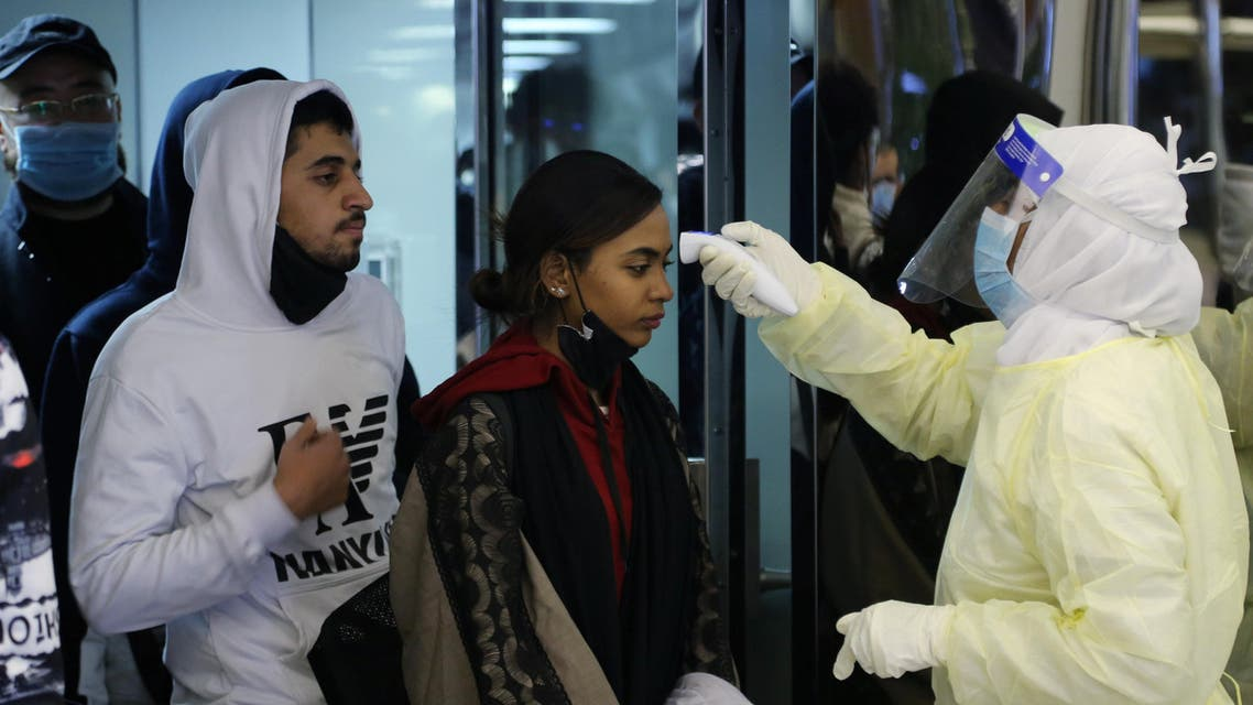Passengers coming from China wearing masks to prevent a new coronavirus are checked by Saudi Health Ministry employees upon their arrival at King Khalid International Airport, in Riyadh, Saudi Arabia. (Reuters)