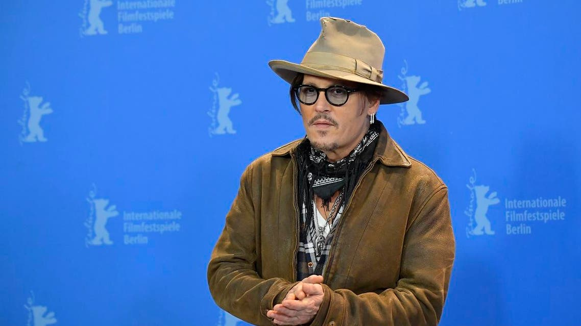 """US actor Johnny Depp poses during a photocall for the film """"Minamata"""" screened in the Berlinale Special Gala on February 21, 2020 at the 70th Berlinale film festival in Berlin. (AFP)"""