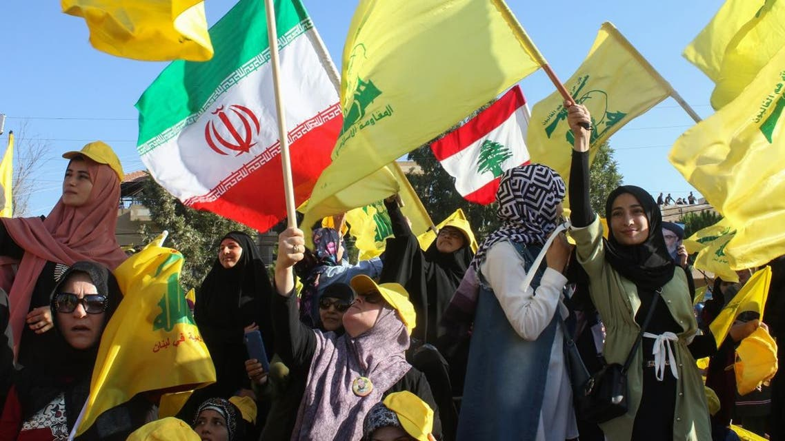 Female supporters of the Lebanese Shiite militant movement Hezbollah wave the group's flag during a commemoration marking the 13th anniversary of the end of the 2006 war with Israel. (File photo: AFP)