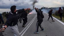 Greek islanders clash with police over new migrant center