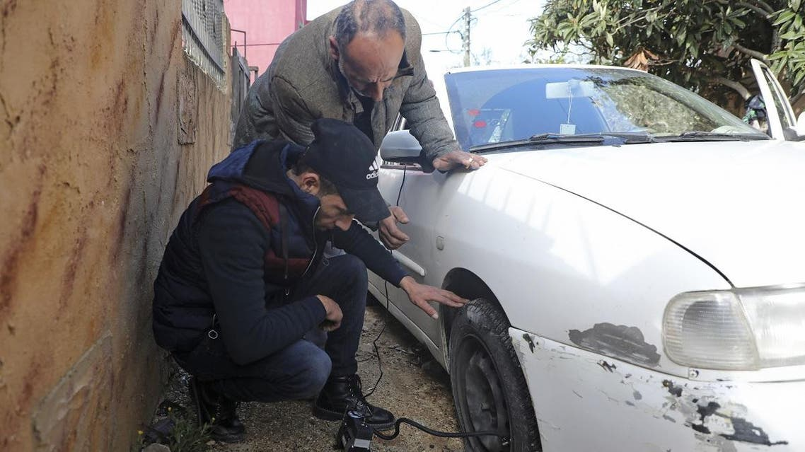 One of the cars which were vandalized in the occupied West Bank village of Yasuf near Nablus on February 26 2020. (AFP)