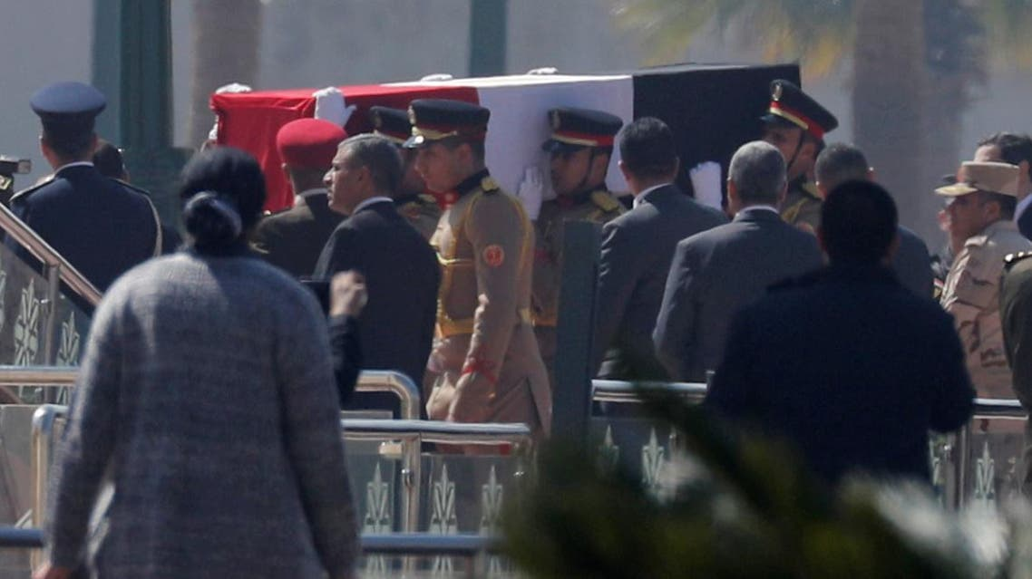 Guards carry the coffin of former Egyptian President Hosni Mubarak at Field Marshal Mohammed Hussein Tantawi Mosque, during his funeral east of Cairo. (Reuters)