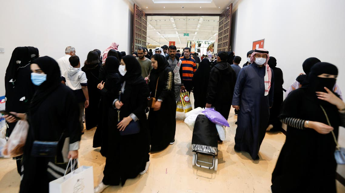 Locals wear face masks to take precautions from coronavirus, as they shop at the Bahrain's Autumn Fair 2020, in Manama, Bahrain January 29, 2020. (Reuters)
