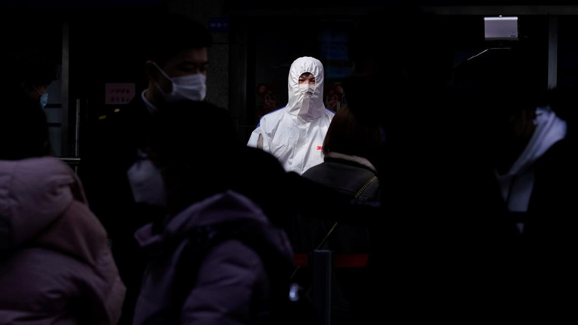 Passengers wearing masks are seen arrival at the Shanghai railway station in Shanghai, China, as the country is hit by an outbreak of a new coronavirus, February 27, 2020. Reuters