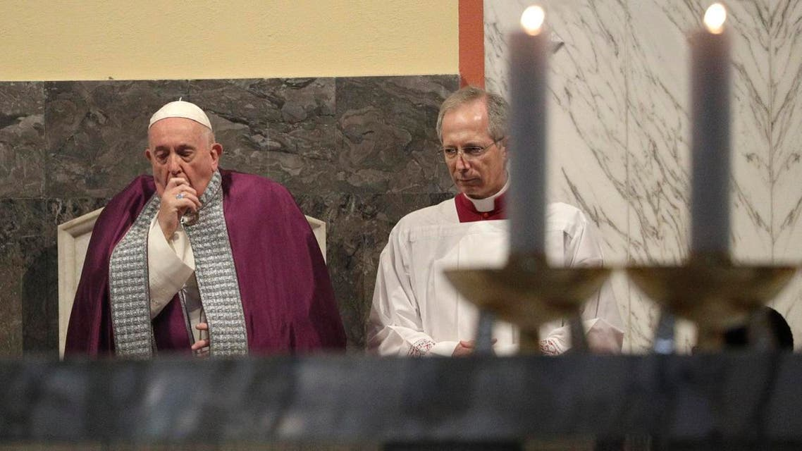 Pope Francis coughs inside the Basilica of Saint Anselmo prior to the start of a procession to the Basilica of Santa Sabina before the Ash Wednesday Mass opening Lent, in Rome. (AP)