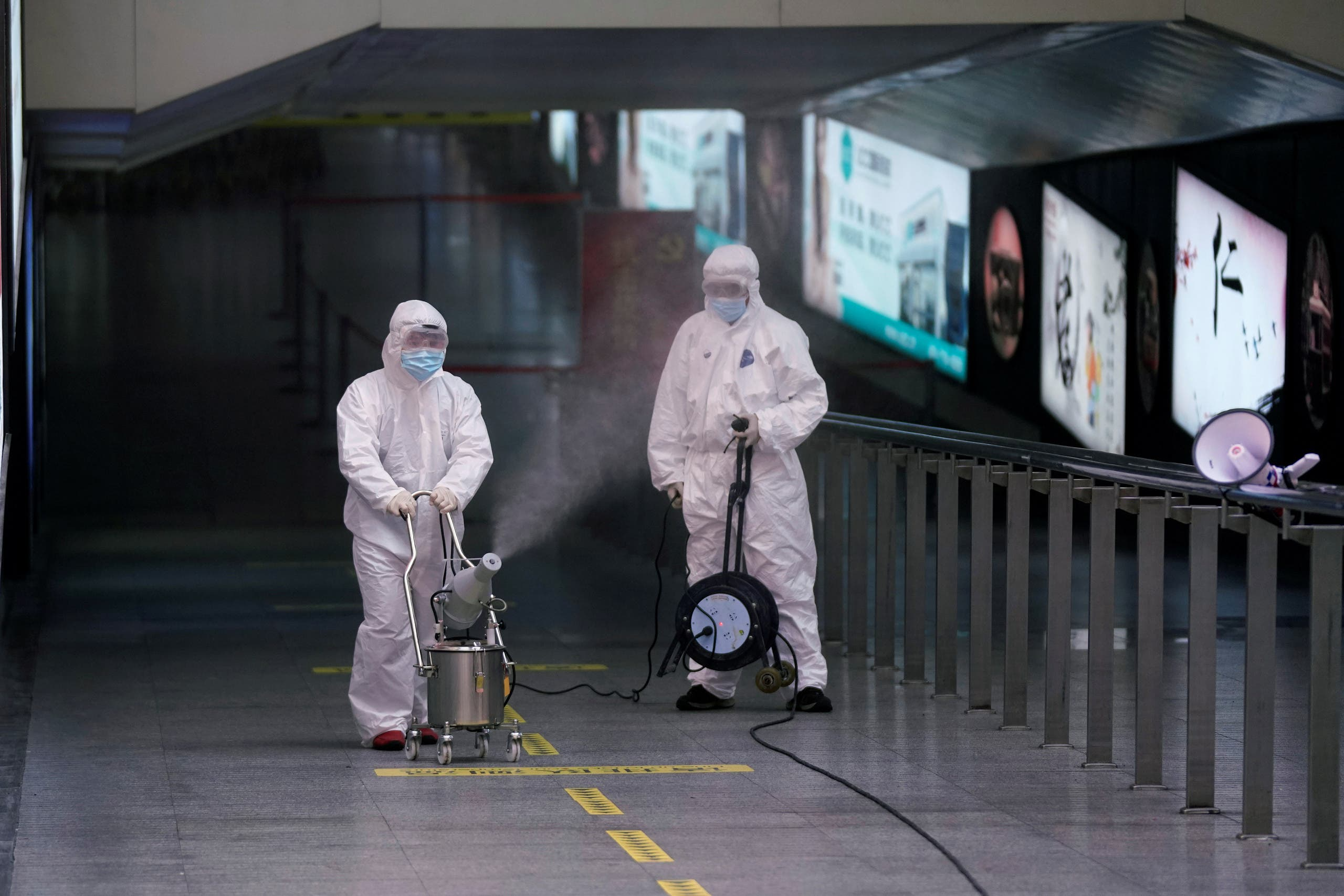 Workers with sanitizing equipment disinfect at the Shanghai railway station in Shanghai, China, as the country is hit by an outbreak of a new coronavirus, February 27, 2020. (Reuters)