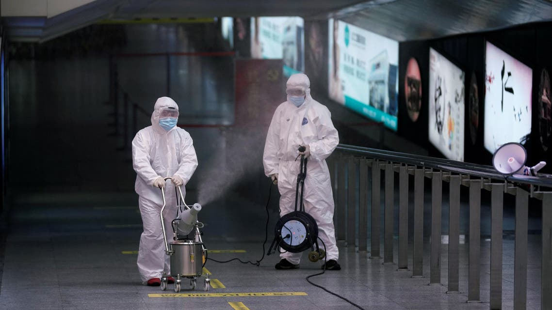 Workers with sanitizing equipment disinfect at the Shanghai railway station in Shanghai, China, as the country is hit by an outbreak of a new coronavirus, February 27, 2020.(Reuters)