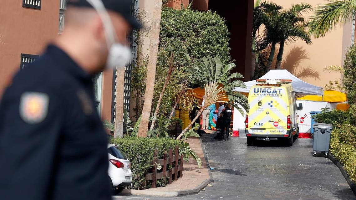 People are seen in H10 Costa Adeje Palace area, which is on lockdown after cases of coronavirus have been detected there in Adeje, on the Spanish island of Tenerife. (Reuters)