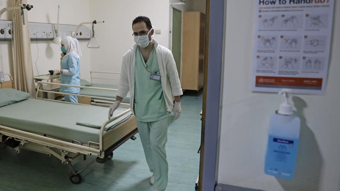 Lebanese nurses wearing protective masks work at a ward where the first case of coronavirus in the country is being treated. (File photo: AFP)