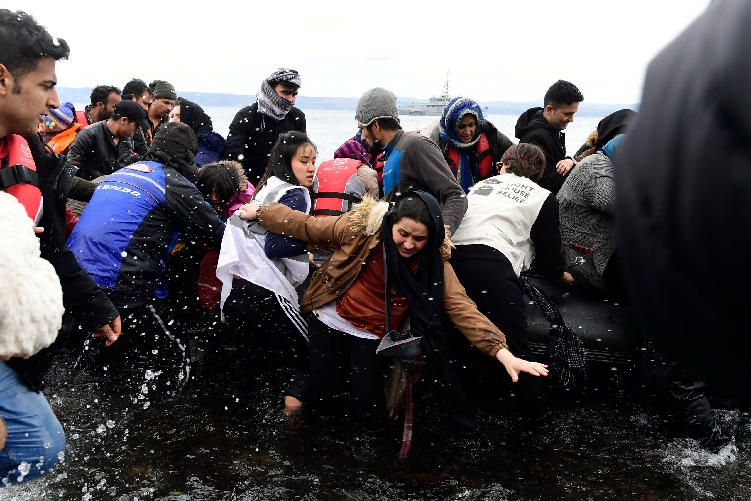 Migrants arrive with a dinghy at the village of Skala Sikaminias, on the Greek island of Lesbos, after crossing the Aegean sea from Turkey, on Friday, Feb. 28, 2020. (AP)