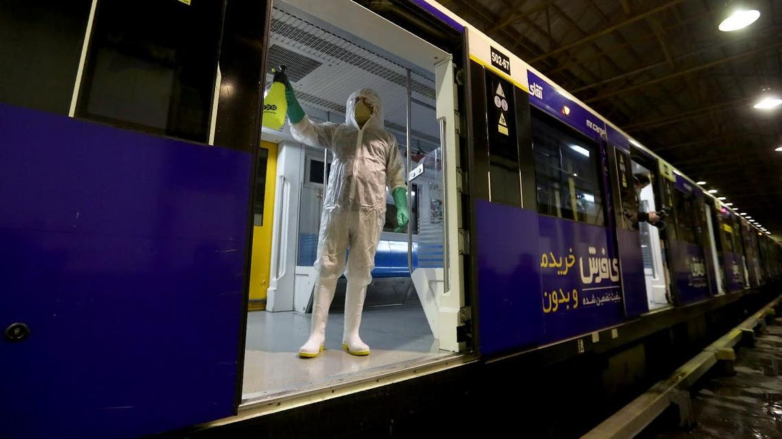A Tehran Municipality worker cleans a metro train to avoid the spread of the COVID-19 illness on February 26, 2020. (Reuters)