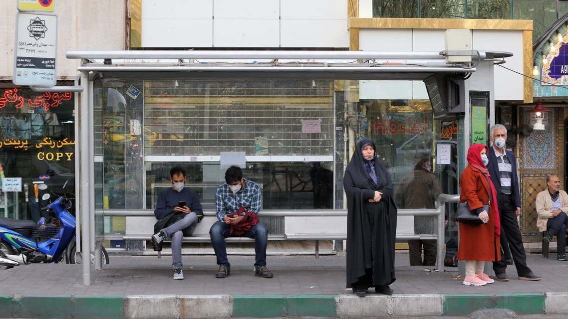 People wearing protective masks wait at a bus station in the Iranian capital Tehran on February 24, 2020. Iran's government vowed on February 24 to be transparent after being accused of covering up the deadliest coronavirus COVID-19 outbreak outside China as it dismissed claims the toll could be as high as 50. The authorities in the Islamic republic have come under mounting public pressure since it took days for them to admit to accidentally shooting down a Ukrainian airliner last month, killing 176 people. Iran has been scrambling to contain the outbreak since it announced the first two deaths in the holy city of Qom on February 19.