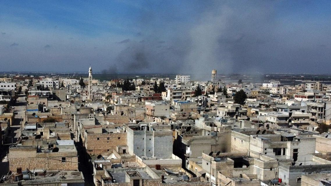 Smoke billows over the town of Saraqib in the eastern part of the Idlib province in northwestern Syria, following bombardment by Syrian government forces, on February 27, 2020. (AFP)