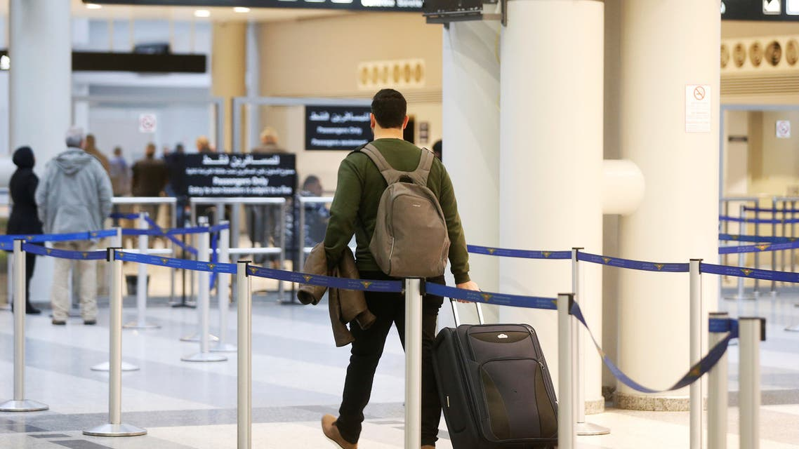 Habib Rahhal, 28, carries his luggage as he heads to board a plane to Germany, at Beirut international airport, Lebanon February 12, 2020. (File photo: Reuters)