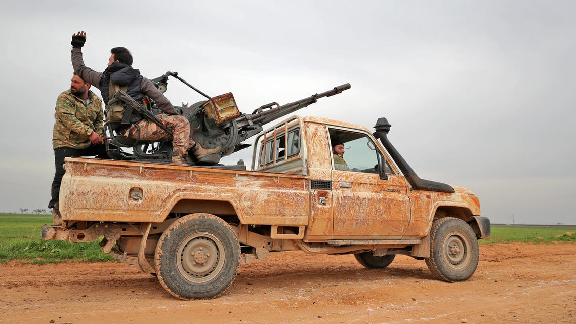 Turkish-backed Syrian rebels drive down a road near the town Taftanaz in northeastern Idlib province, on February 28, 2020. (AFP)