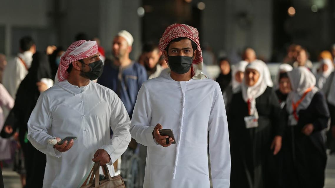 Muslim pilgrims wear masks at the Grand Mosque in Saudi Arabia's holy city of Mecca on February 28, 2020. (AFP)