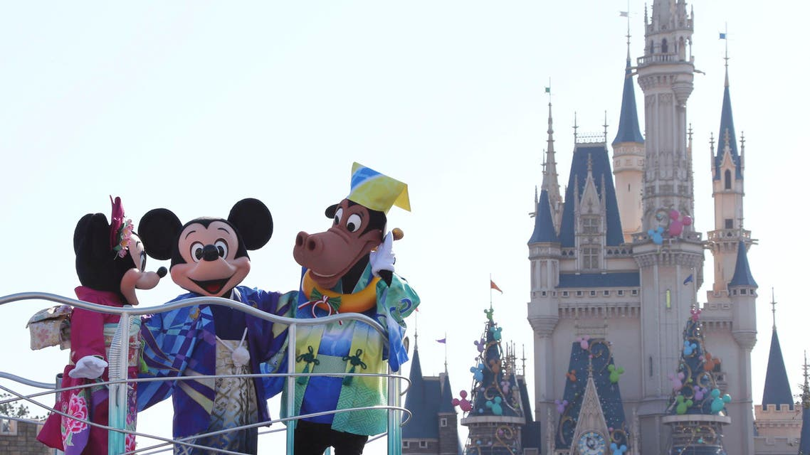 In this photo, Mickey Mouse, Minnie Mouse, and Horace Horsecollar entertain visitors to the Tokyo Disneyland. (File photo: AP)
