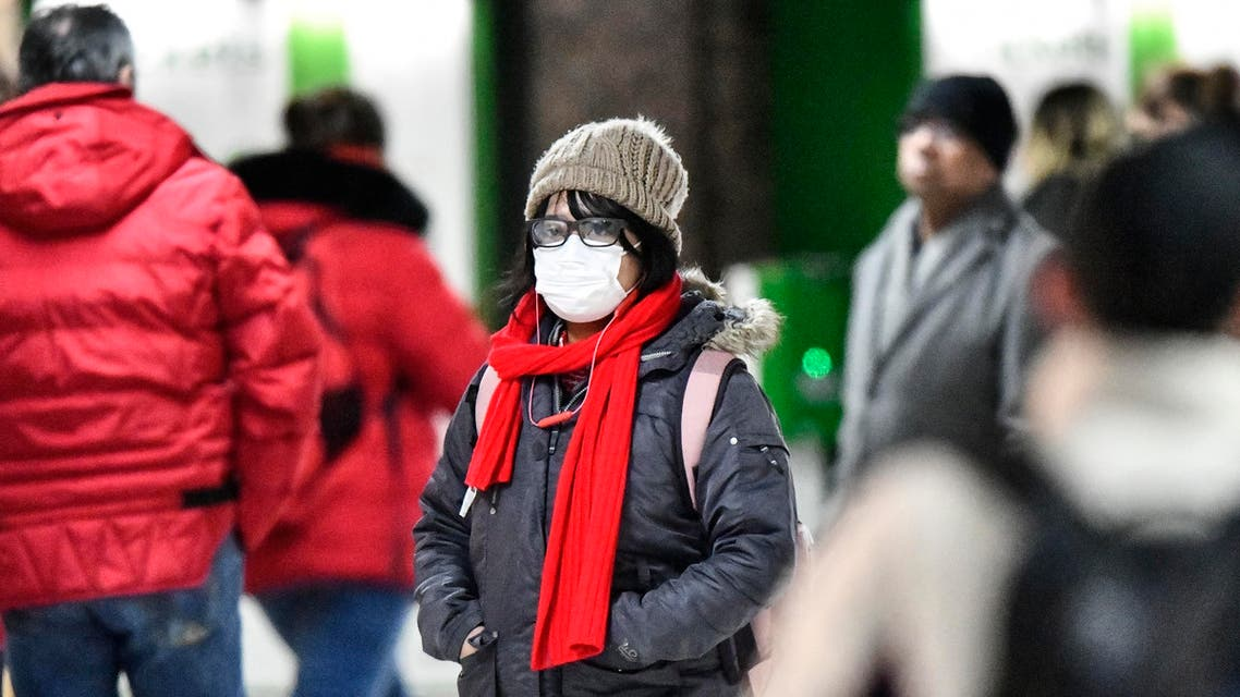 A woman wears a face mask at the main train station in Duesseldorf, Germany, Wednesday, Feb. 26, 2020. (AP)